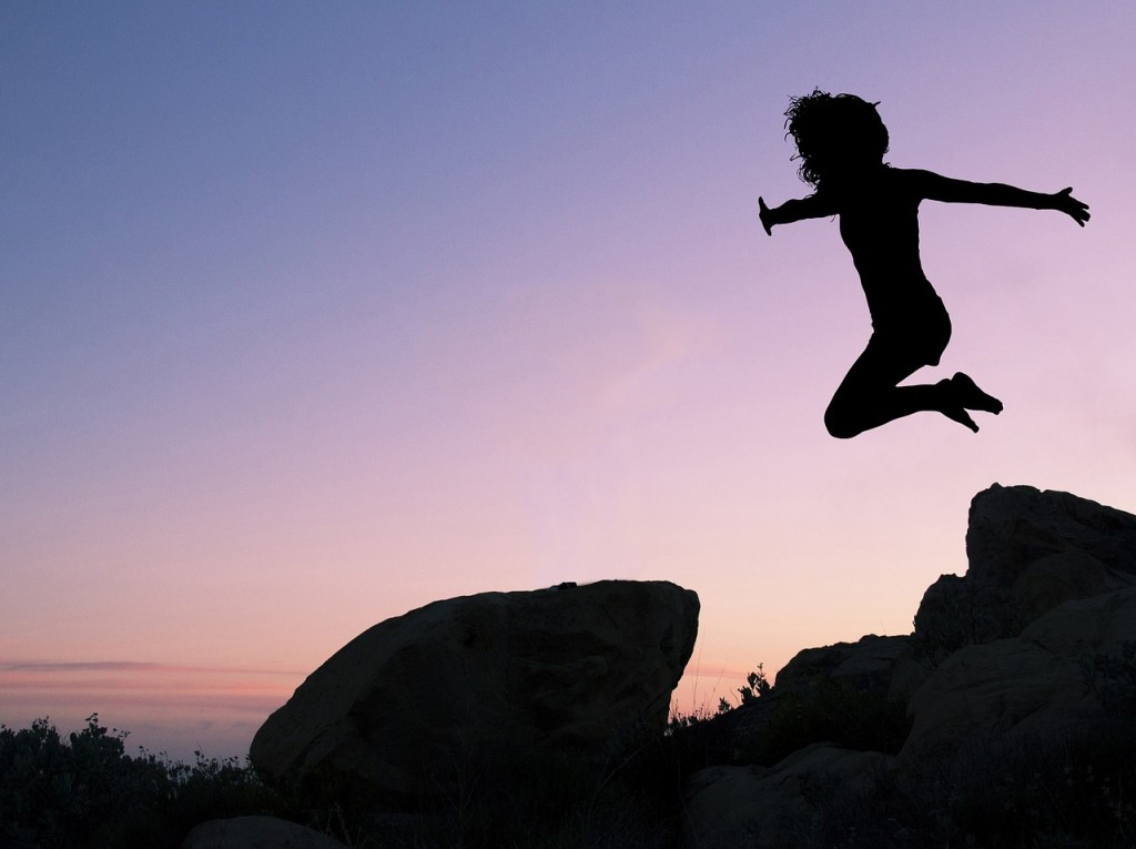 Living Life to The Fullest. Why You Need To! A person jumps through the air, only their silhouette is shown.