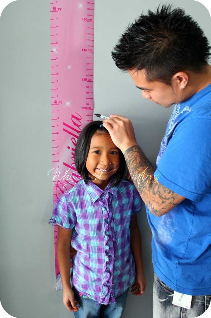 Look Who's Growing Growth Charts and Gabby being measured by Darasak.