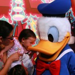 Donald duck and Mimi kissing him on the beak.