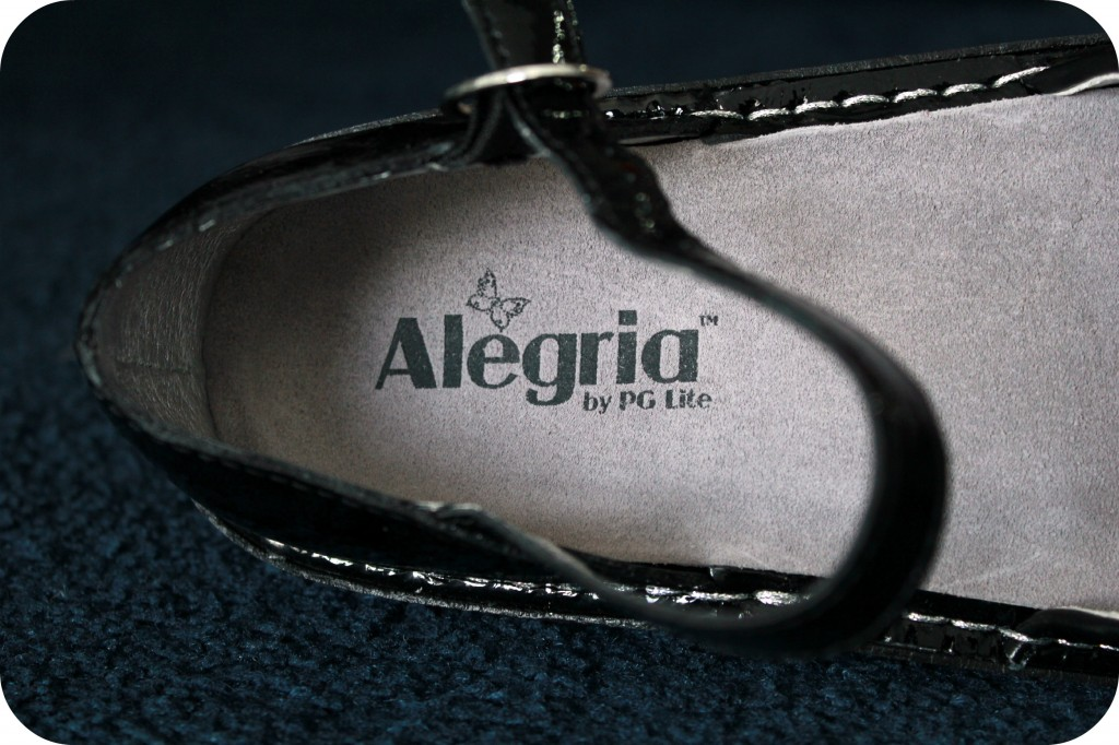 A close of up of the Alegria logo is shown inside the shoe.