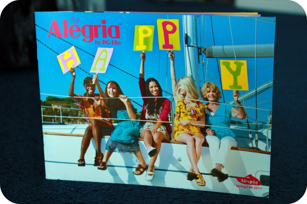 Alegria Shoes pamphlet with happy woman on a boat.
