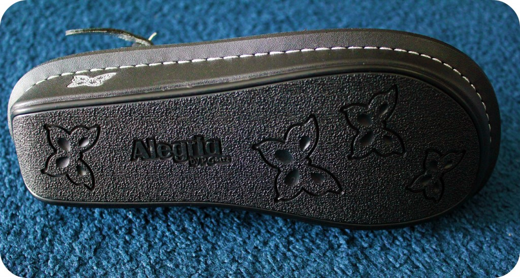 A shoe lays on its side, showing the sole.