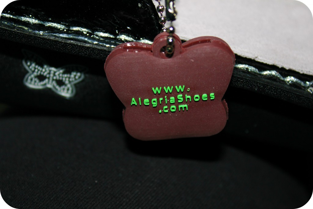 A close up of Alegria Shoes keychain is shown.