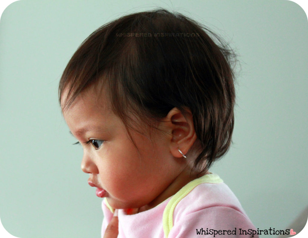 A Baby Is Shown With Her Ears Pierced