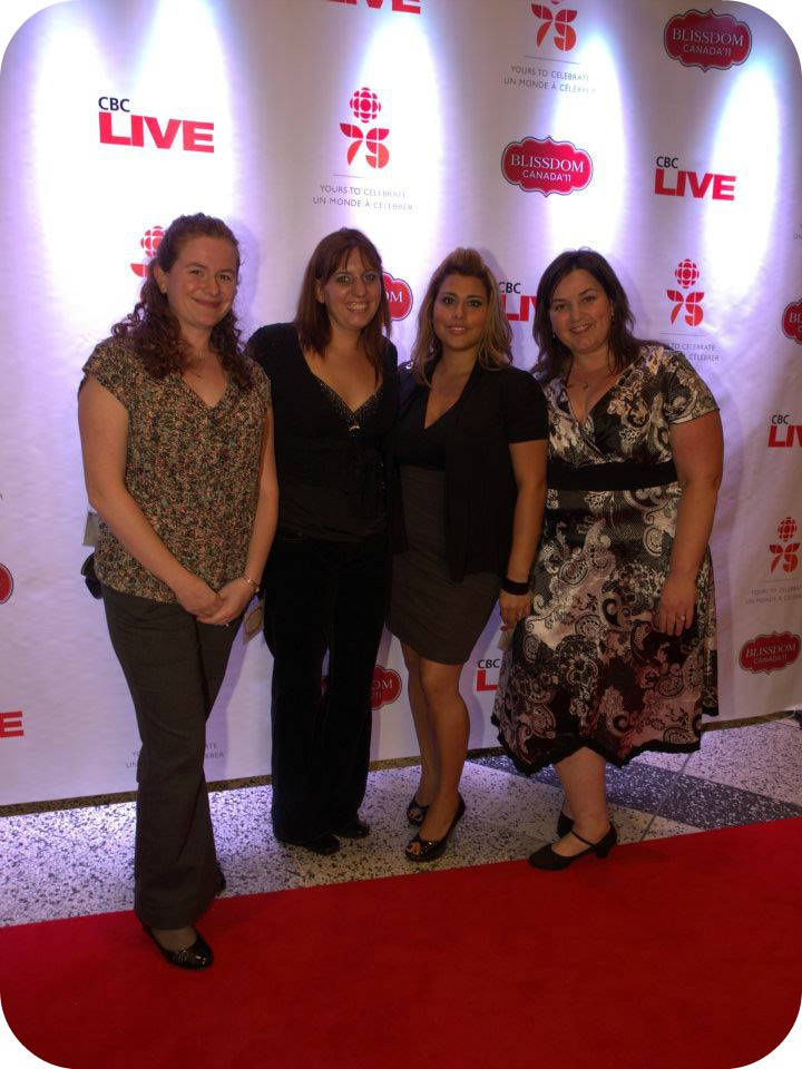 A group of women post in front of the CBC Live sign.
