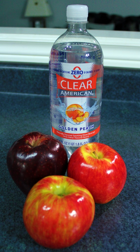 Zero Calorie, Golden Peach Clear American Bottle stands with shiny apples.