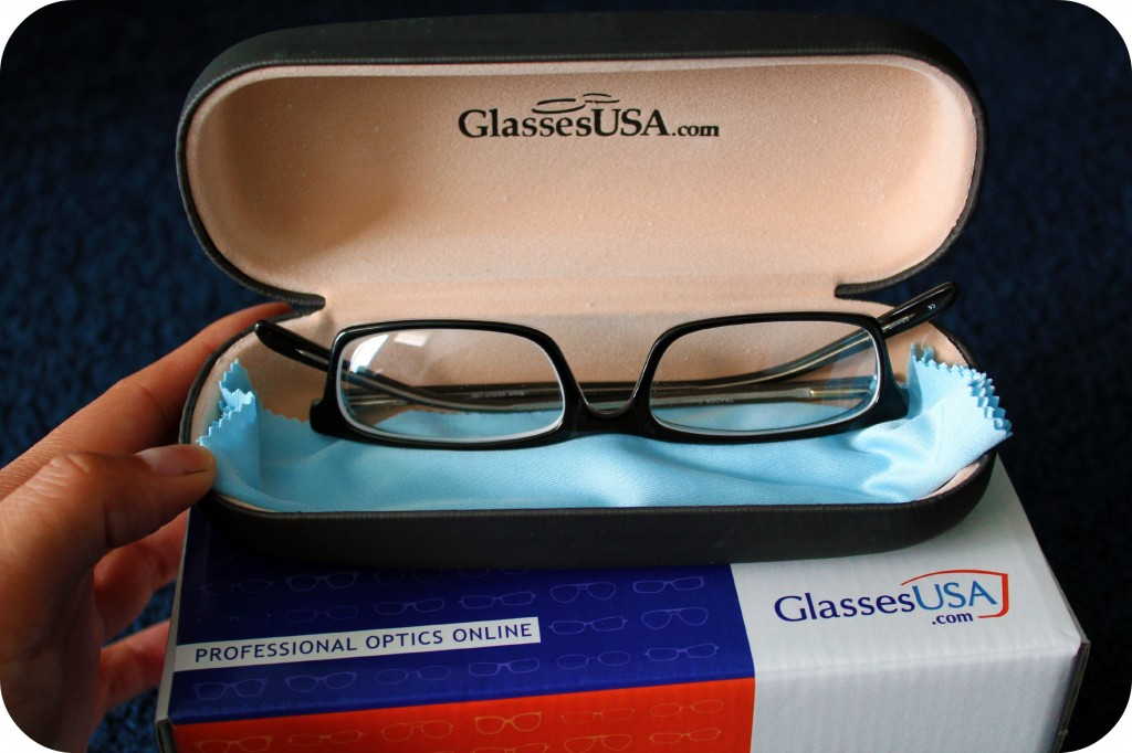 Glasses are displayed inside their case.