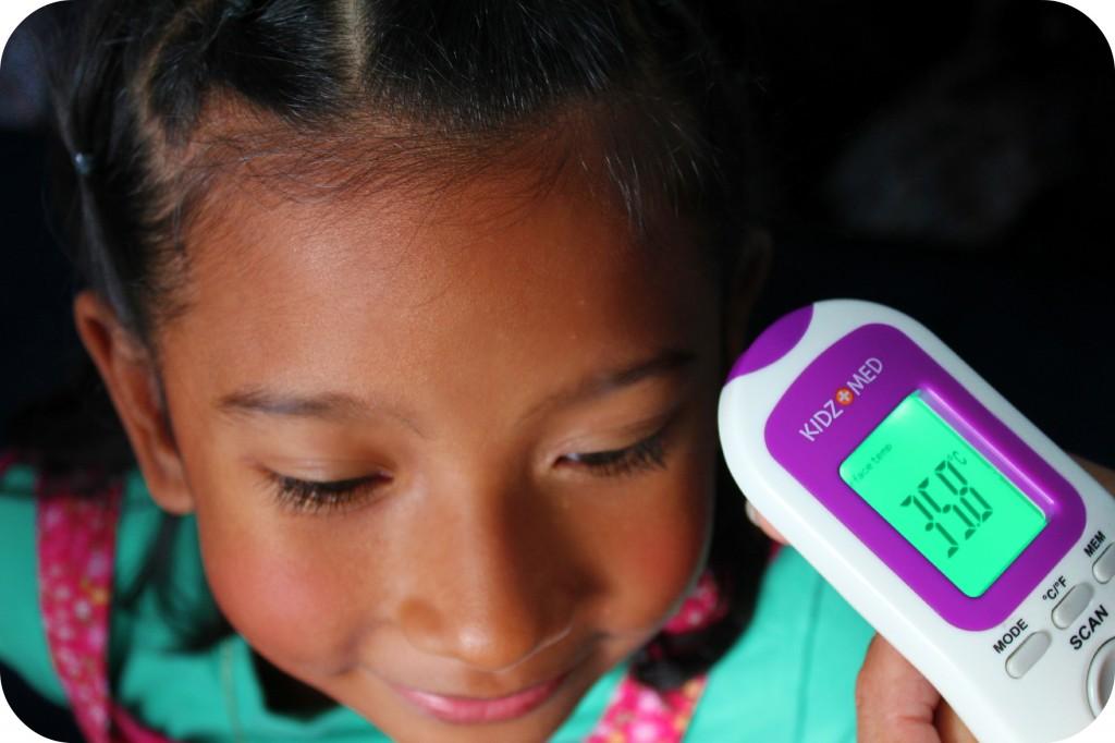 Child gets her temperature taken.