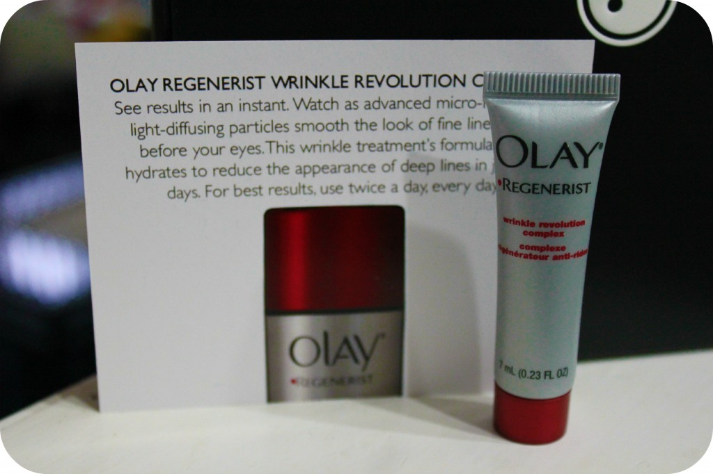 Olay Regenerist Wrinkle Cream in front of a informative post card.