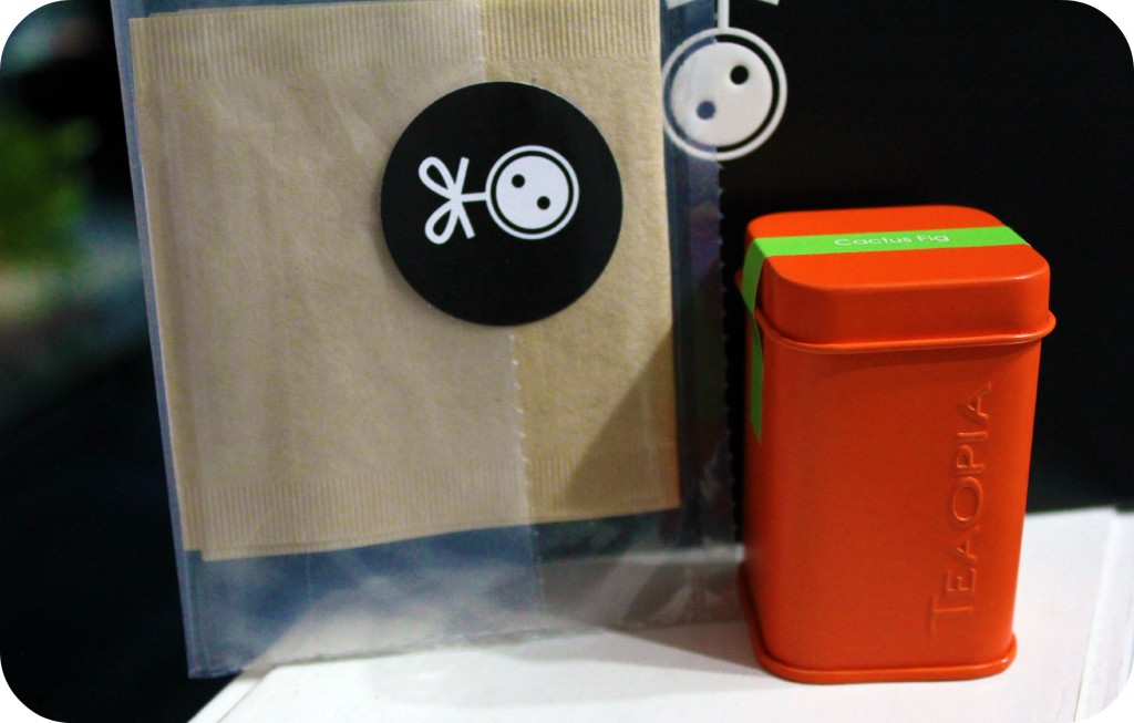 An orange canister of Teaopia.