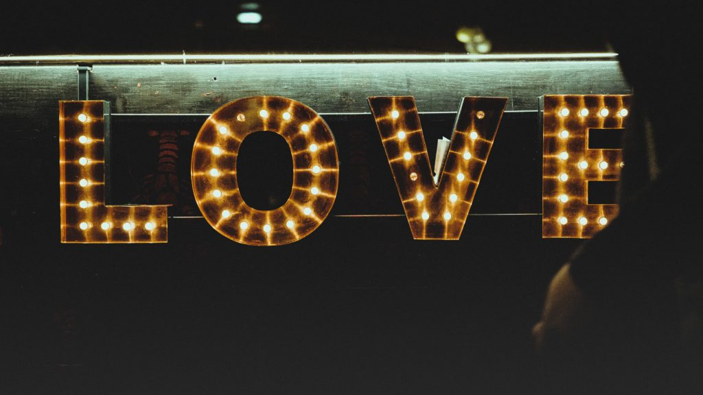 A light marquee with the word love.
