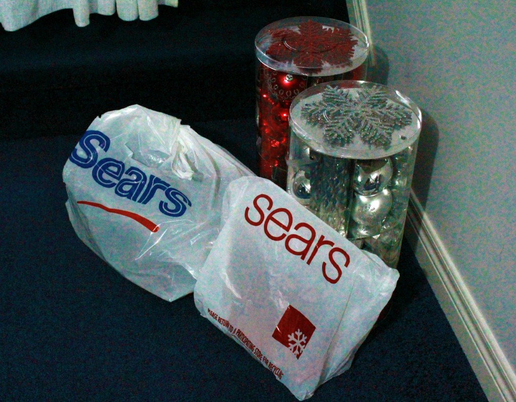 Sears bags filled with tree trimming decorations.