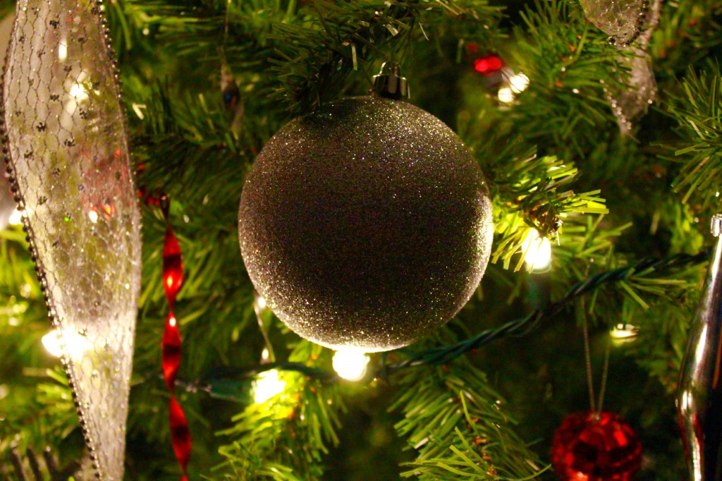 An ornament is shown lit up on the Christmas tree.
