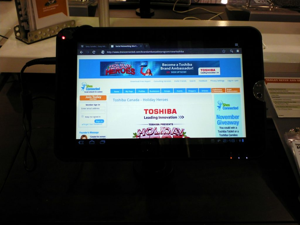 The Toshiba tablet with ShesConnected page loaded on it.