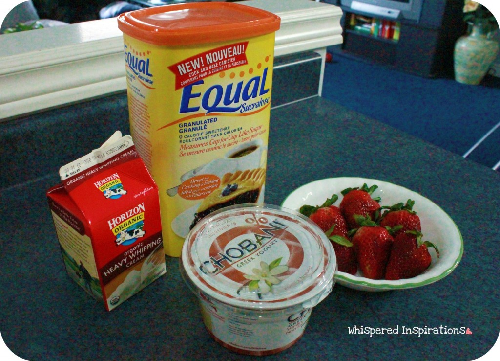 A tub of Equal, cream, yogurt and strawberries.