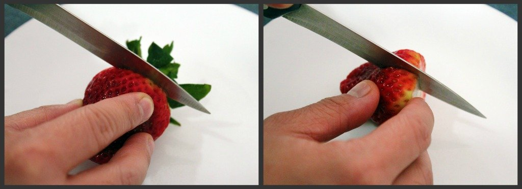 Cutting strawberries for recipe.