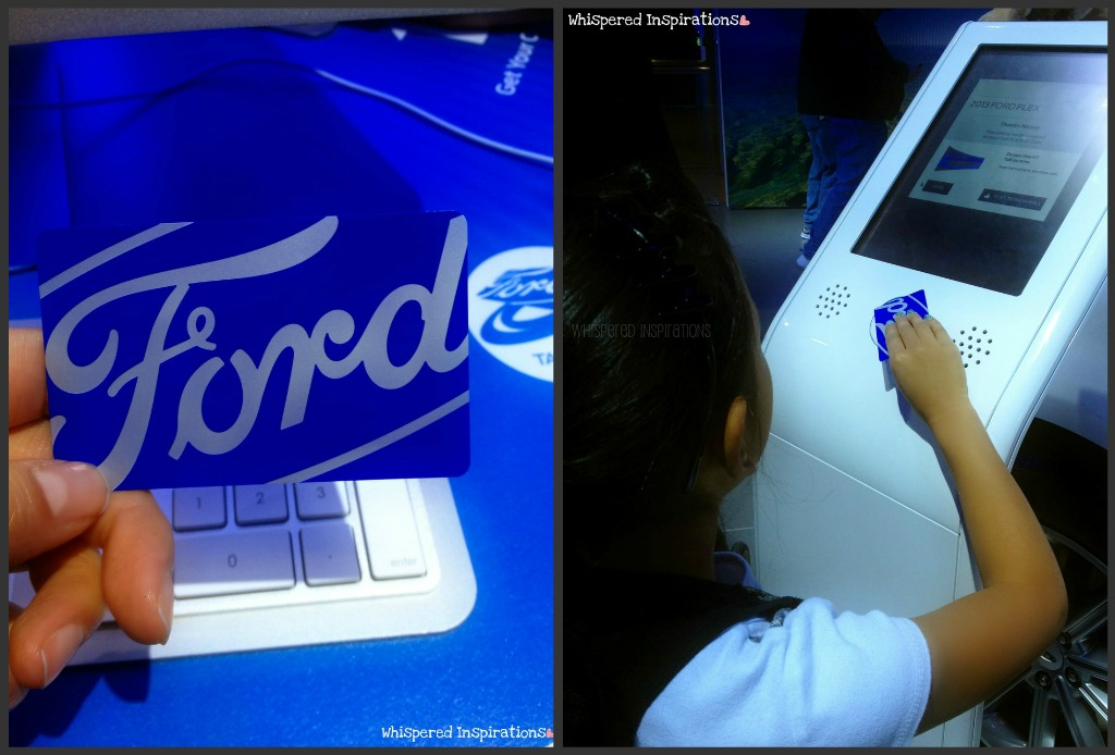 A little girl scans a card at the Auto Show at the Ford booth.