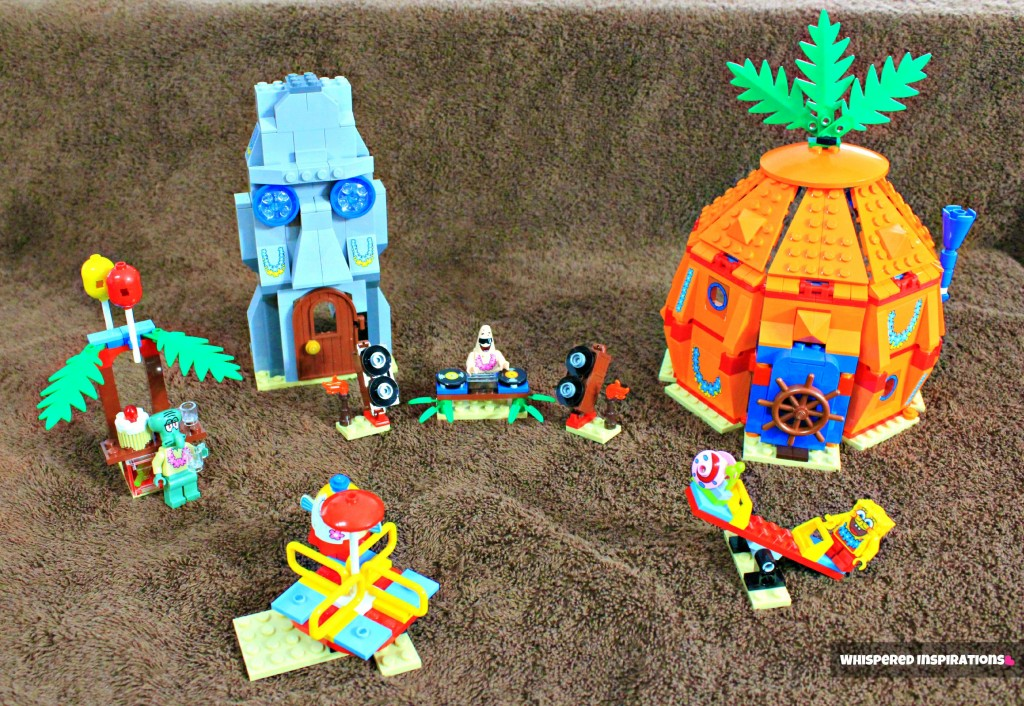 The whole set from the LEGO Spongebob set on a brown towel that looks like sand.