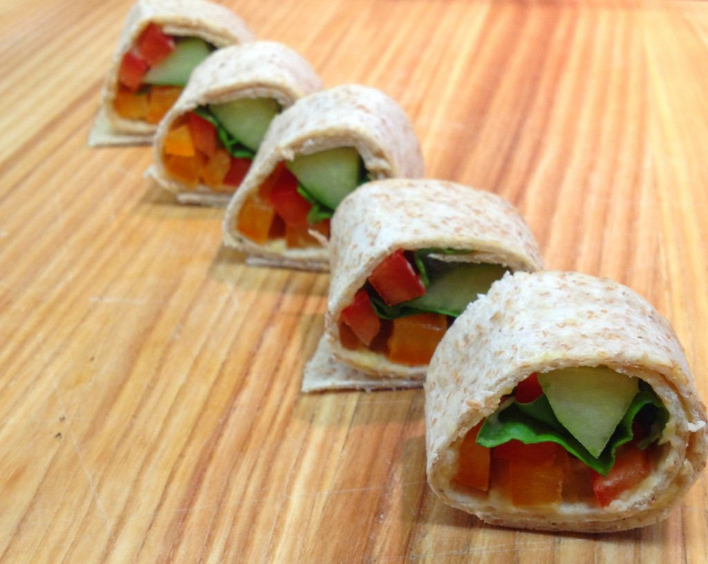 Tortilla sushi made with veggies and cheeses.