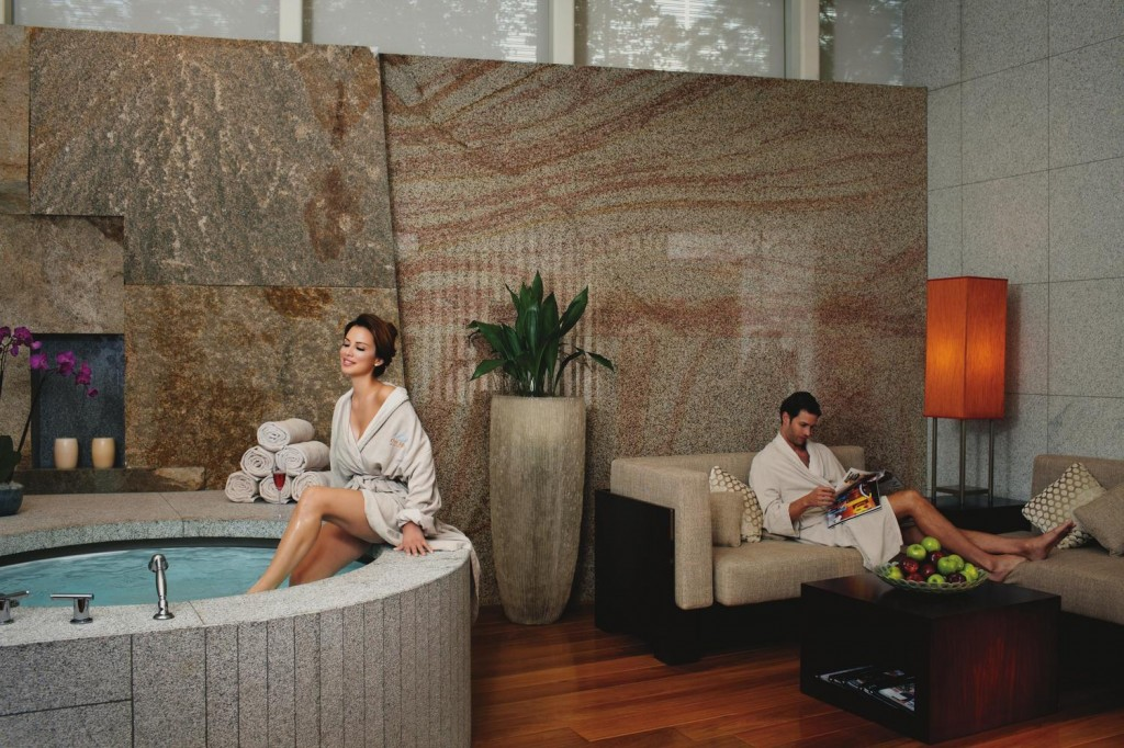 A couple enjoy their room with an in-suite spa.