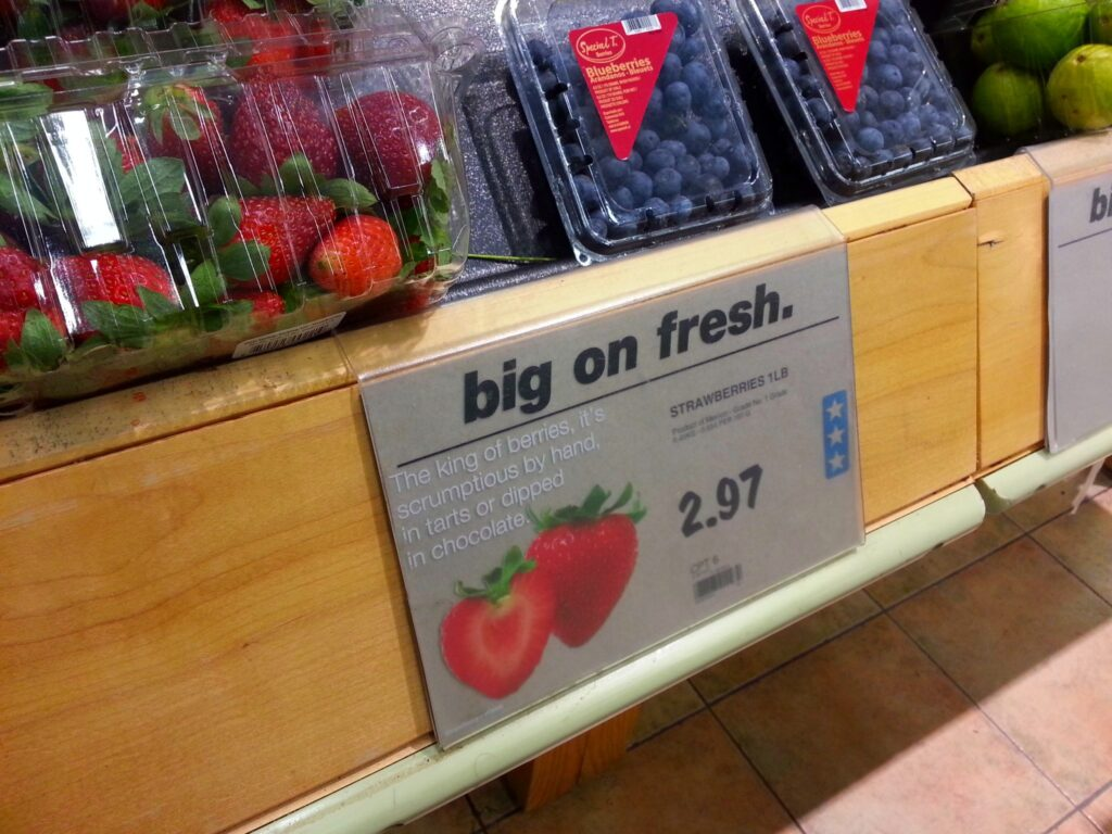 The Real Canadian Superstore Loblaws sign showing $2.97 for strawberries.