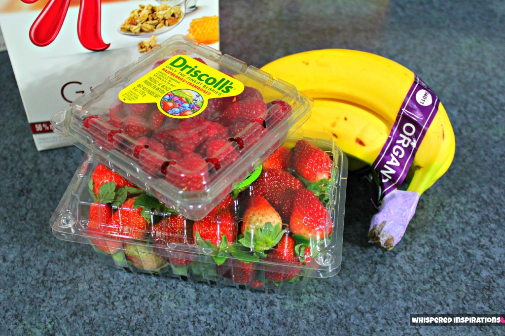 Strawberries, granola, bananas, and raspberries.