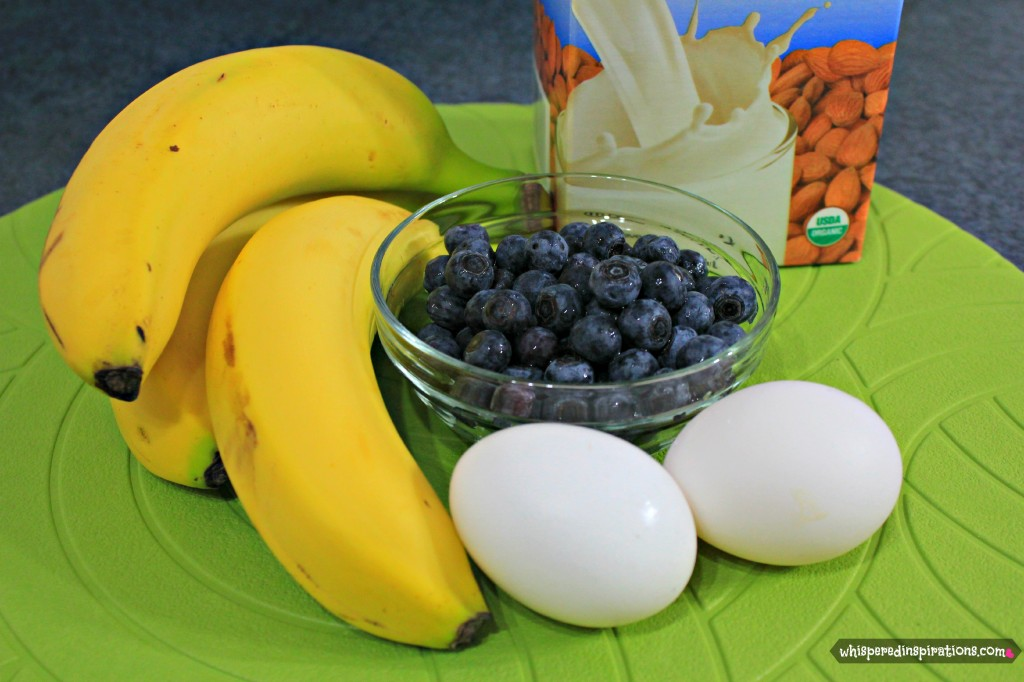 Almond milk, bananas, blueberrries, and egss are shown.