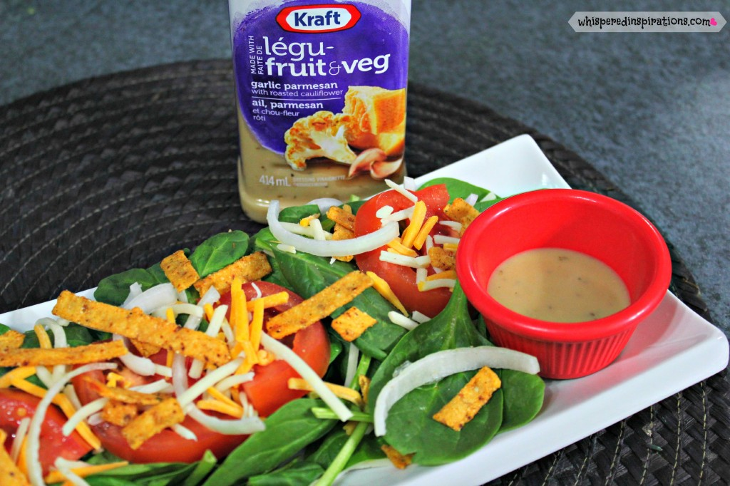 NEW Kraft Pourables in Garlic Parmesan is on the side for a skinny spinach salad.