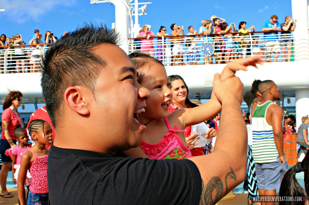A little girl dances with her dad at Disney Dream Sail Away party.