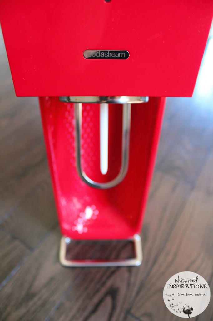 Red SodaStream machine.