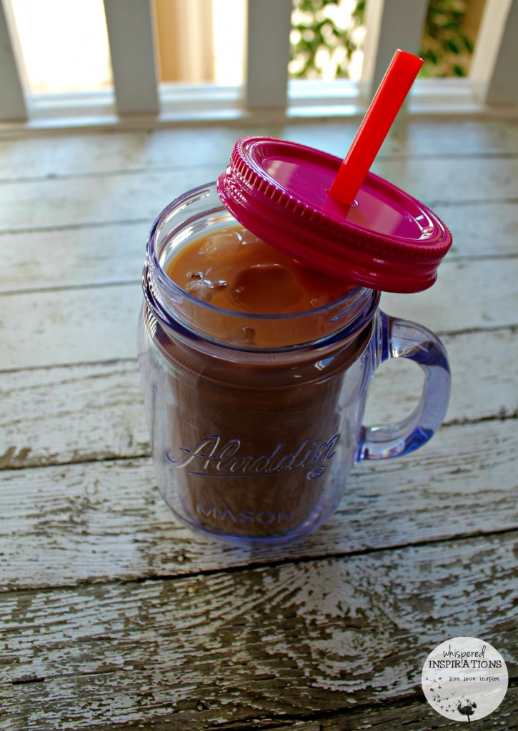 Iced coffee is shown in a portable mason jar, made with compatible pods.
