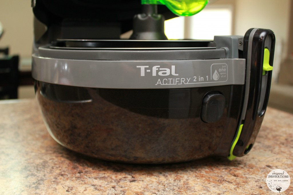 A front view of the T-fal Actifry 2 in 1 and what is used to make air fryer buffalo wings and potato wedges.