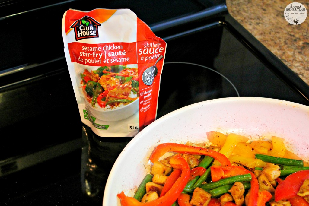 Clubl House Sesame Chicken Stir-fry skillet sauce is ready to be poured onto the meat and veggie mix.