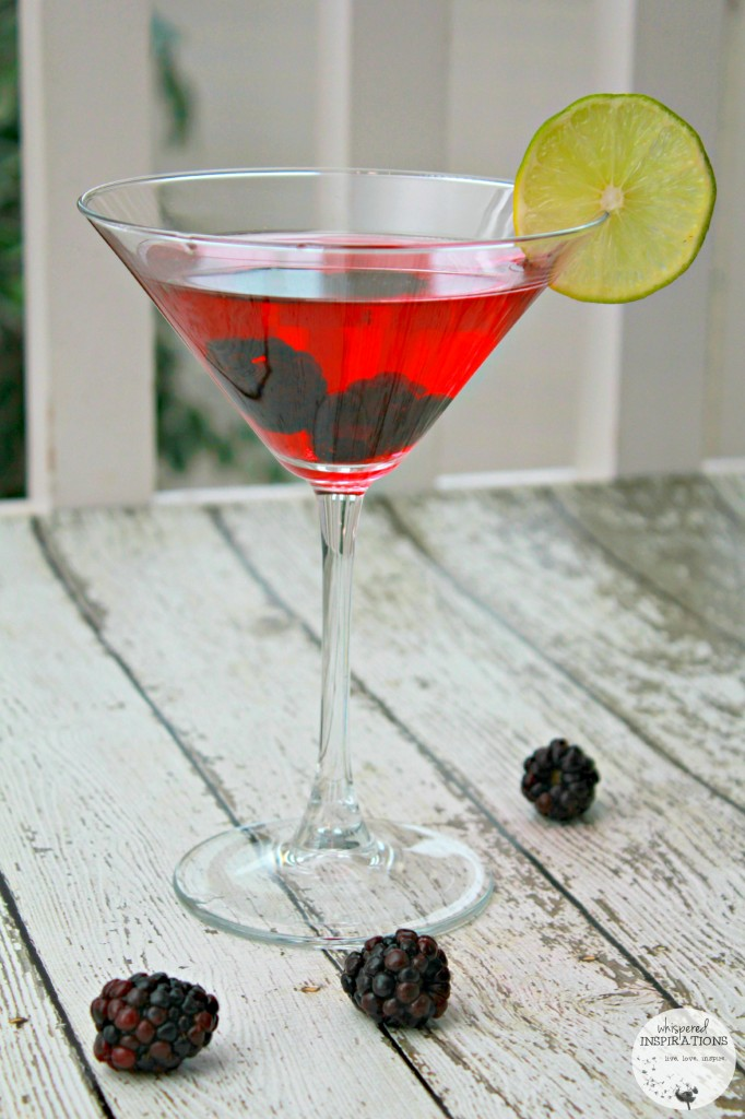 A cocktail is shown and dubbed Cupid's Arrow, it's pink with blackberries and lime.