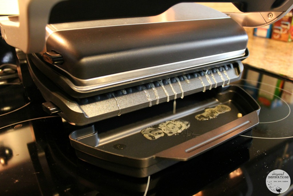 T-fal Optigrill being used and dripping fat onto tray.