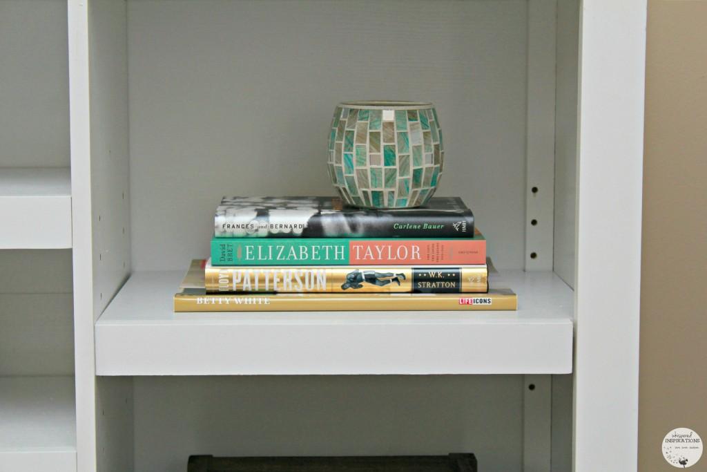 A stack of books in a book shelf.
