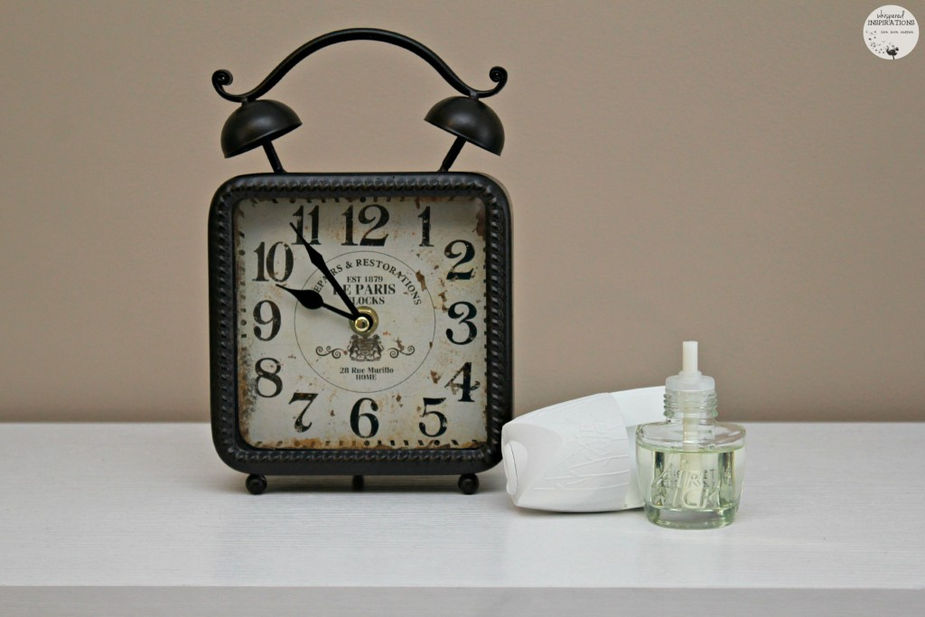 Clock with Air Wick next to it.