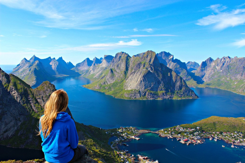 Girl Sits on Edge of Mountains. Travel safe with Allianz Insurance.