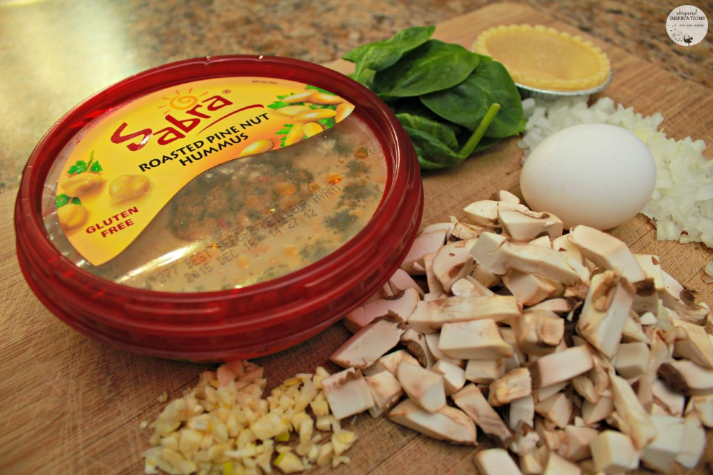 Sabra Roasted Pine nut hummus being incorporated into a mini quiche recipe.