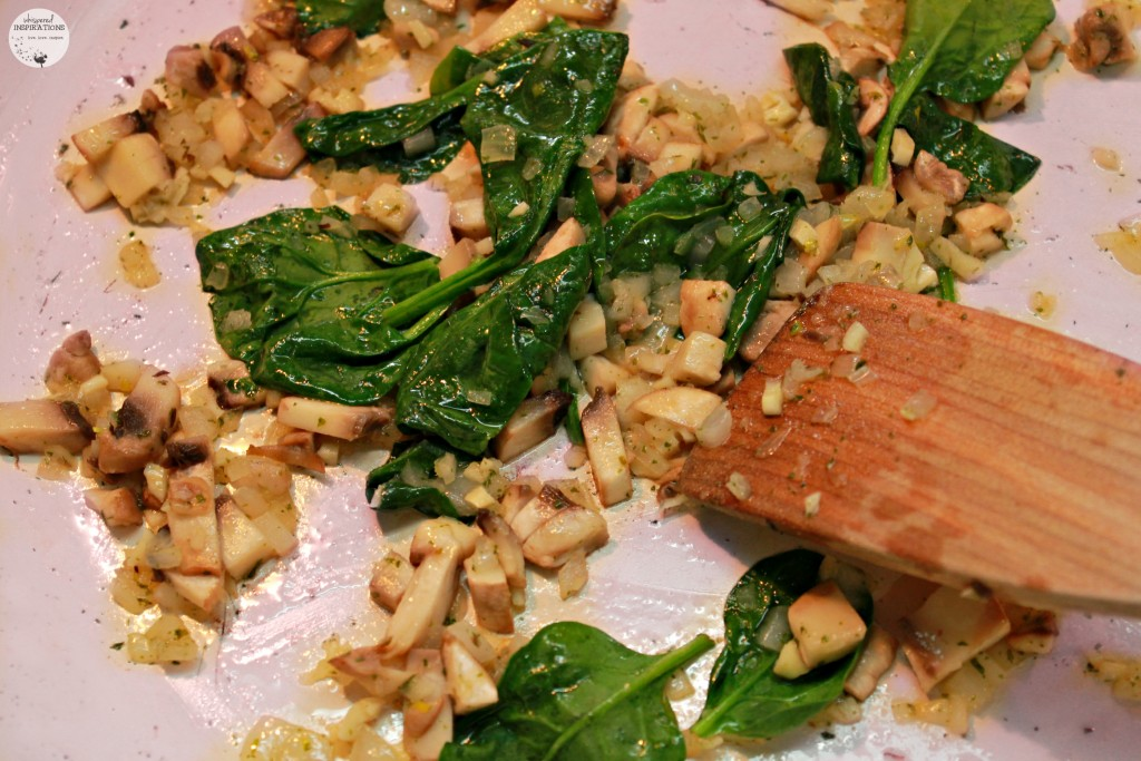 Spinach added to sauteed mushrooms, onion, garlic, and butter.