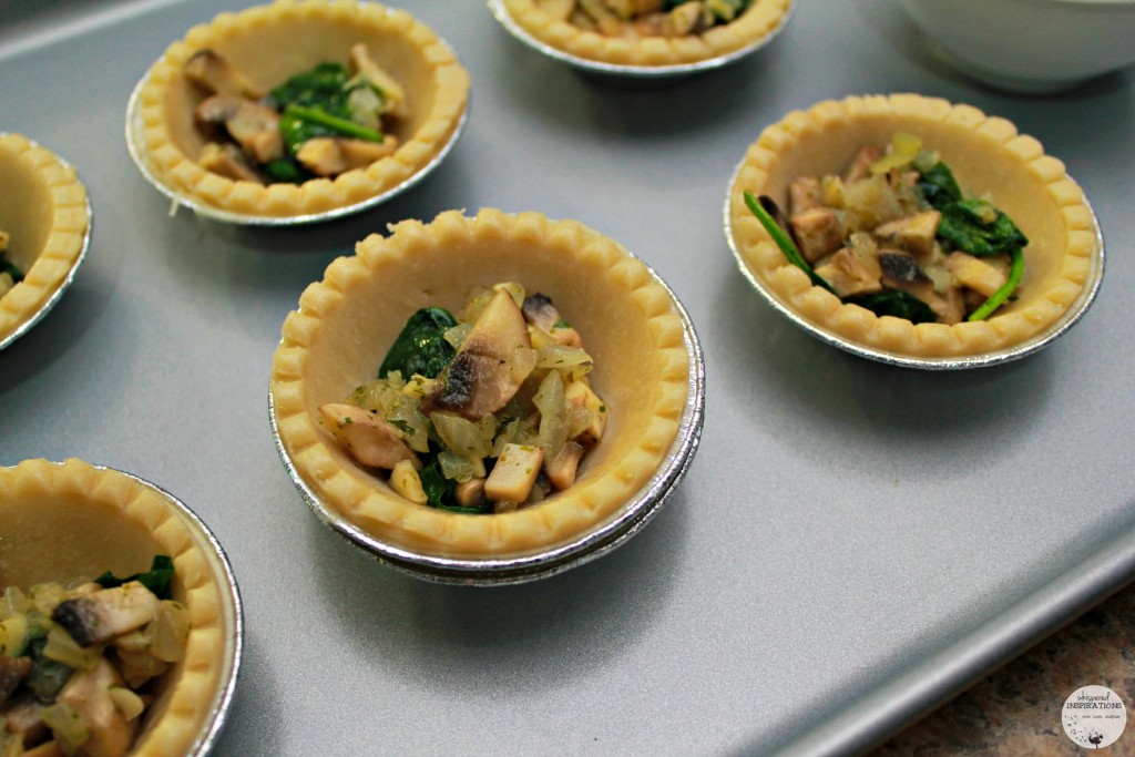 Mini pie shells filled with vegetable mixture.