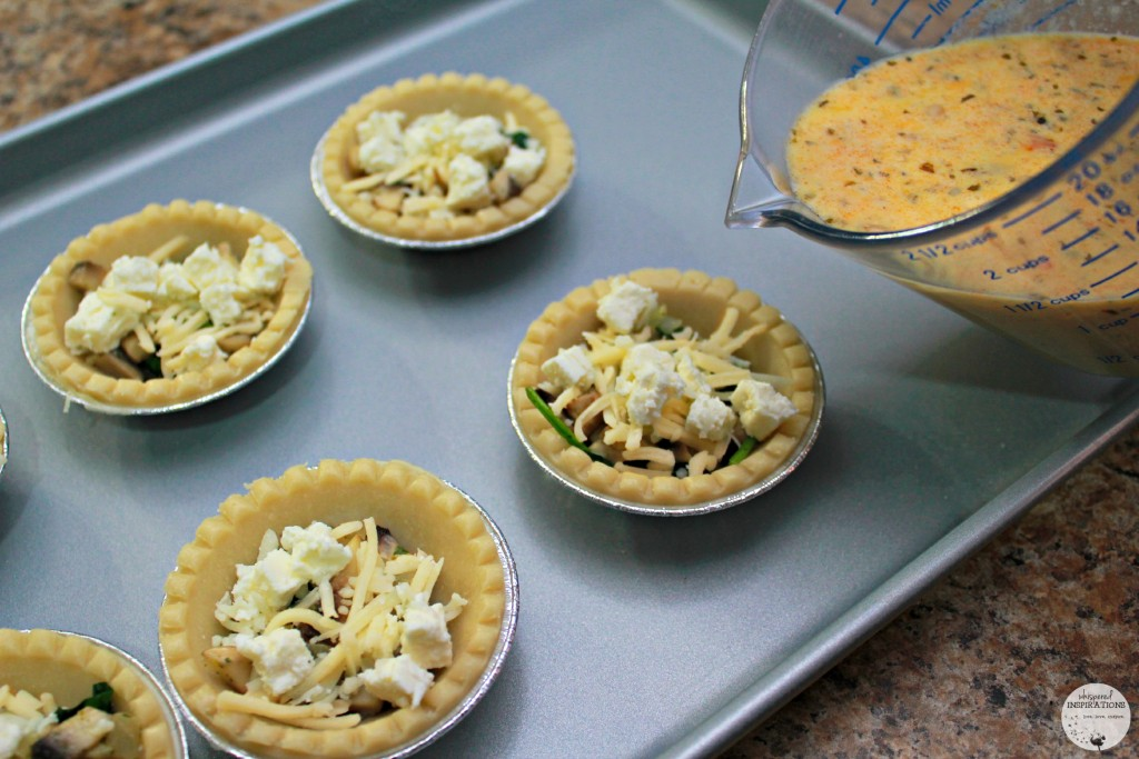 Mini pie shells are then filled with feta and gruyere cheese and being filled with egg mixture.