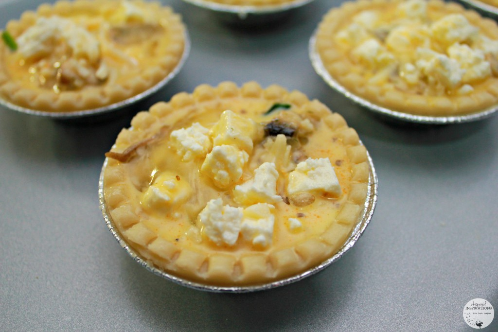 Egg mixture is added to cheese and vegetable mixture.