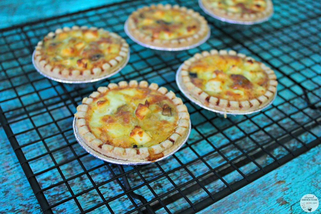 Mini Quiches cool on baking sheet.