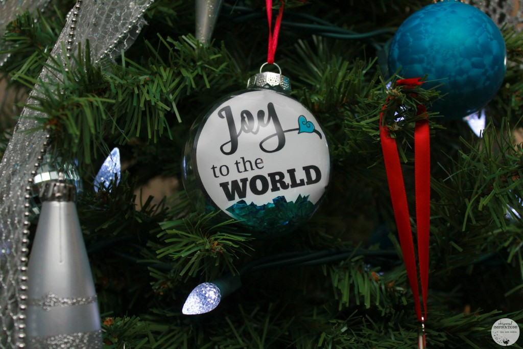 DIY Joy to the World ornament added to the tree.