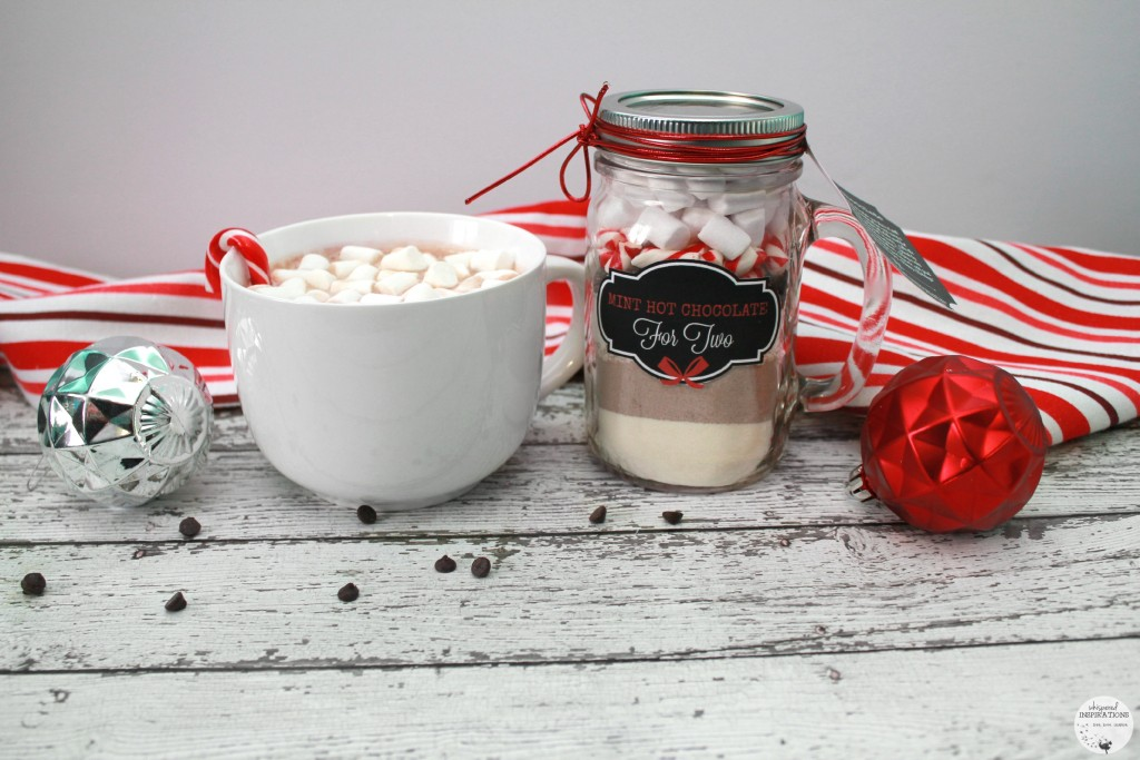 Mint Hot Chocolate is prepared into a huge mug and the homemade gift in a mason jar with a label.