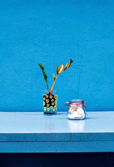 A blue and bright wall and table.