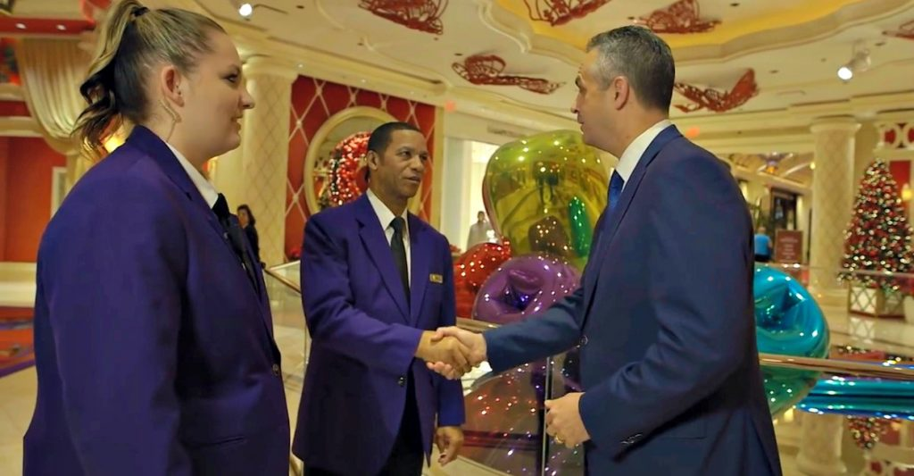 Troy, VP of Security at the Wynn, shakes hands with his employees.