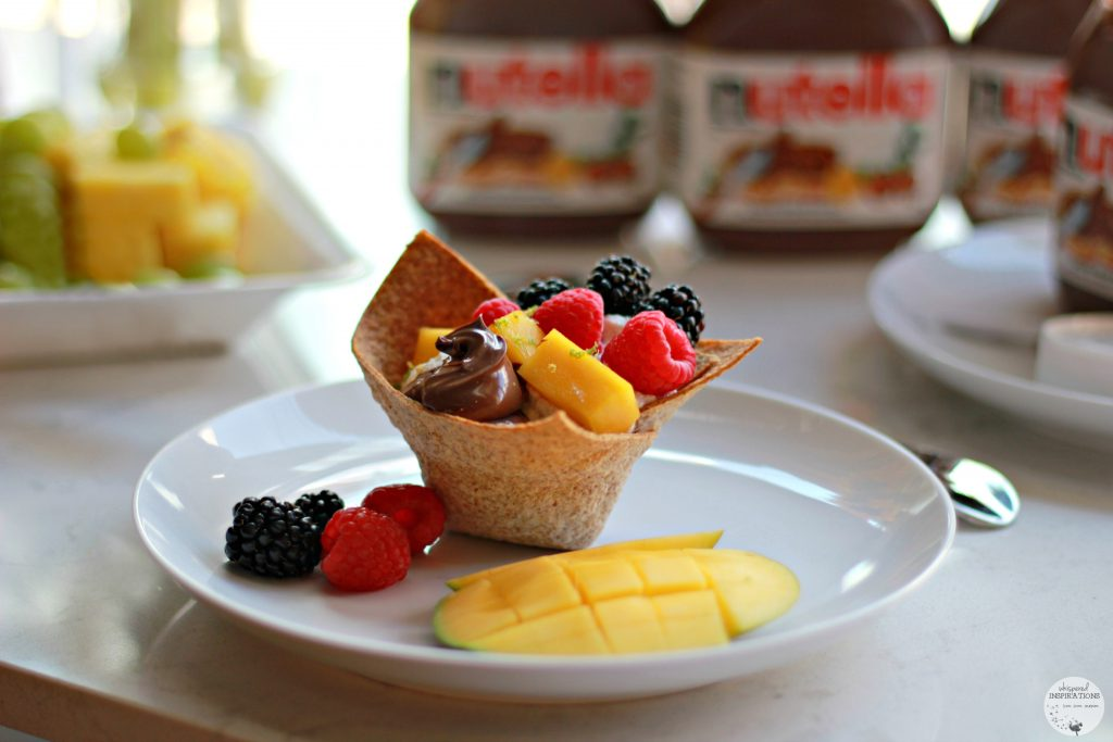 Tortilla bowl filled with Nutella, fruits, and more.