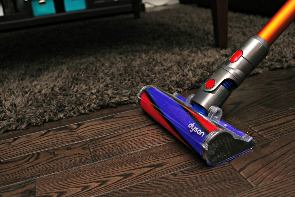 The Dyson V8 Absolute attachment on hardwood flowers.